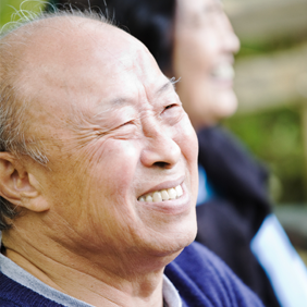 Smiling Asian man loves the restorative dentistry options available in Newport News at Port Warwick Dental Arts, including fillings, inlays, crowns, and bridges.